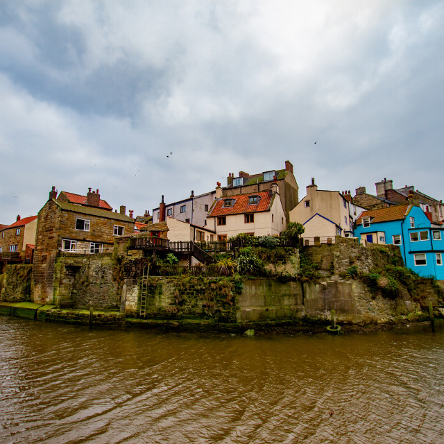 """Staithes at high tide, Yorkshire East Coast, England."" stock image"