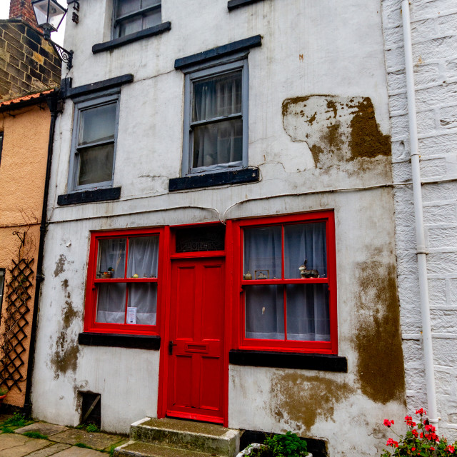 """Staithes, Yorkshire East Coast, England, High Street, Cottage with Red Entrance Door"" stock image"