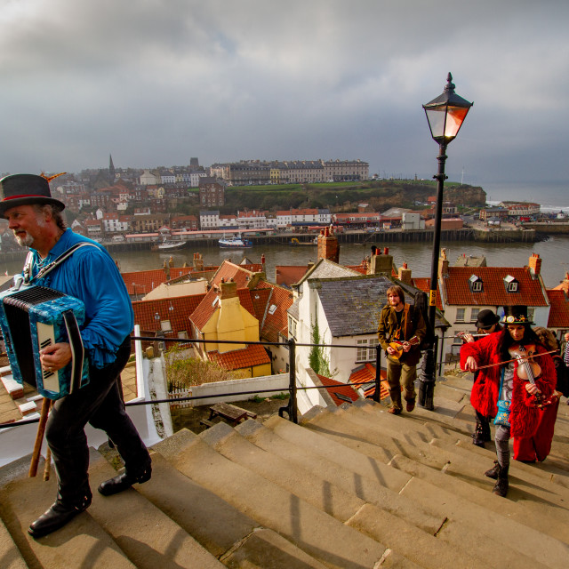 """""""Folk Musicians Climbing the Whitby Abbey Steps. Yorkshire, England."""" stock image"""