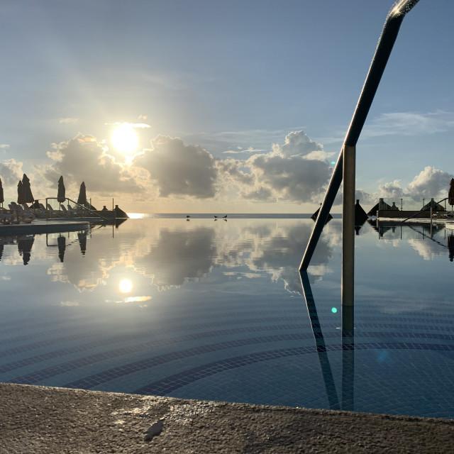 """infinity pool at sunrise"" stock image"