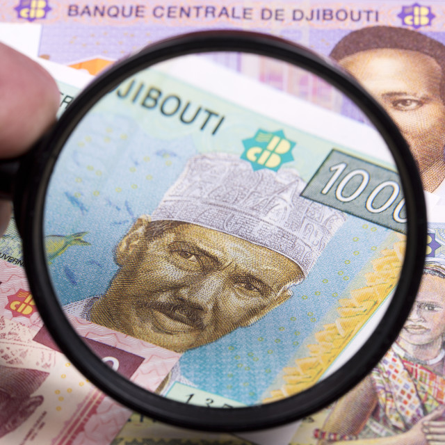 """Djiboutian money in a magnifying glass"" stock image"