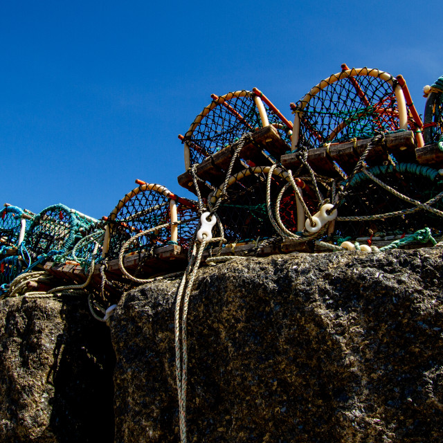 """Lobster Pots at Staithes Harbour Wall, Yorkshire East Coast, England."" stock image"