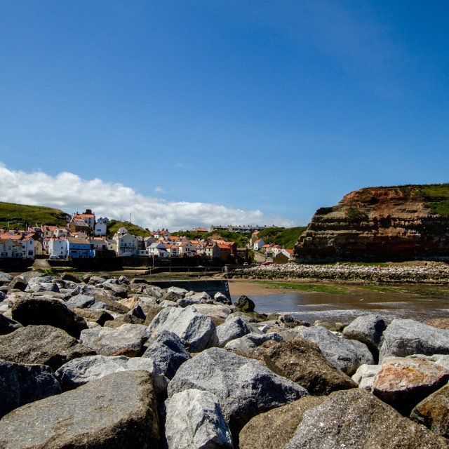 """Staithes and Cowbar Nab, Rock Sea Defence to the Foreground. Yorkshire Coast, England."" stock image"