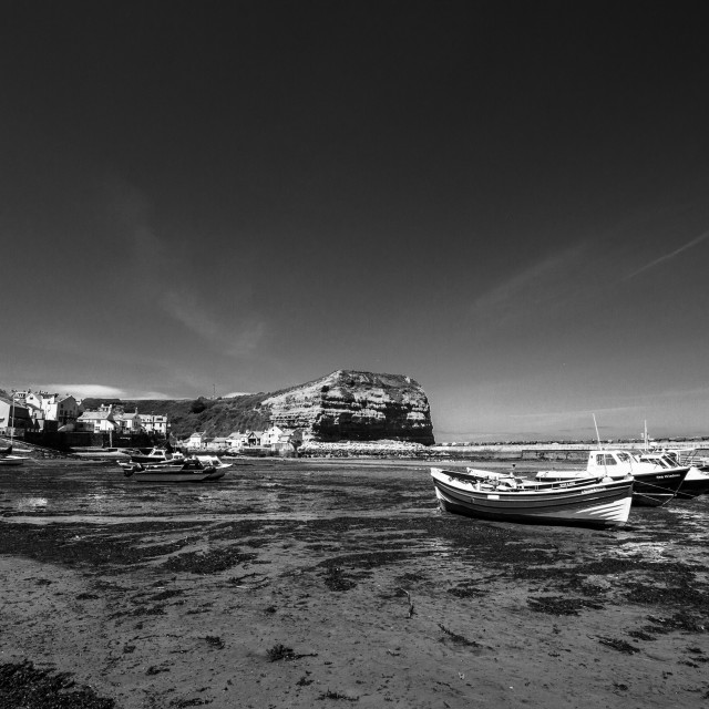 """Staithes and Cowbar Nab, Fishing Boats to the Foreground. Yorkshire Coast, England. (monochrome)"" stock image"