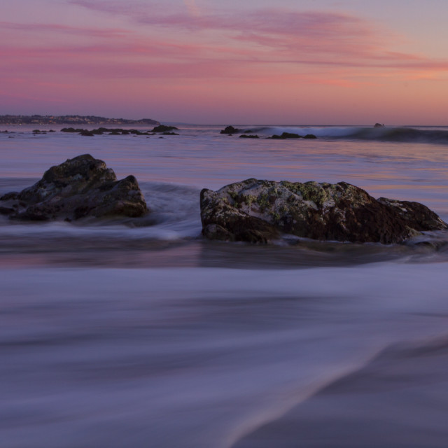 """""""Pink and purple skies over the beach"""" stock image"""
