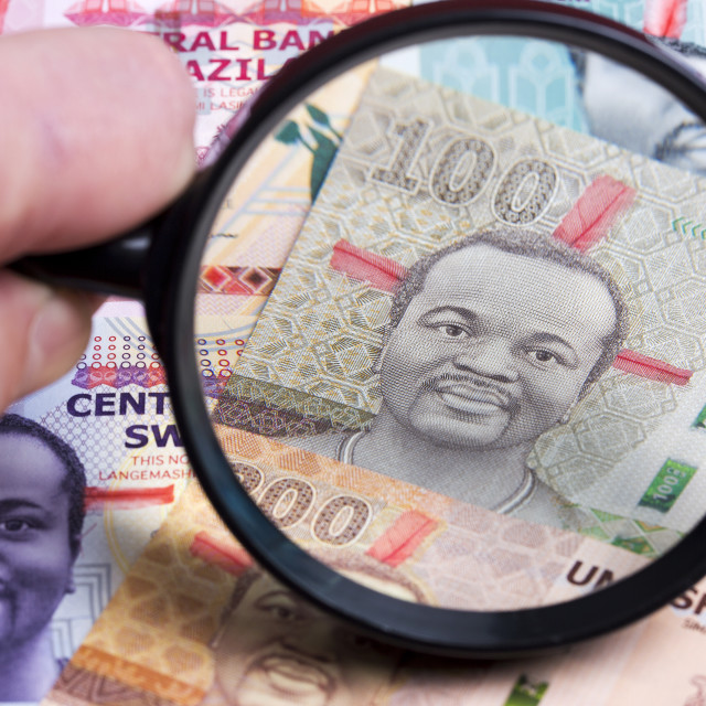 """Swazi money in a magnifying glass"" stock image"