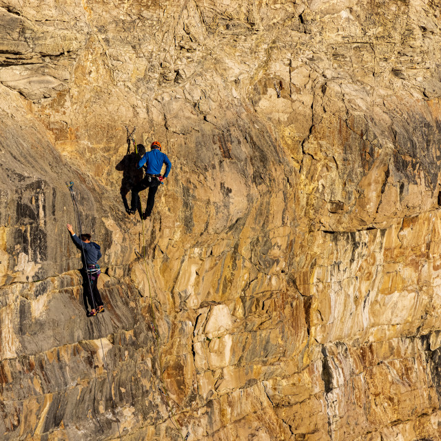 """""""Rock climbers on the cliffs at Dancing Ledge, Purbeck"""" stock image"""