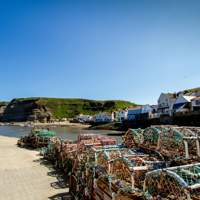 """Lobster Pots Stacked on North Side of Staithes Harbour, Yorkshire, England."" stock image"