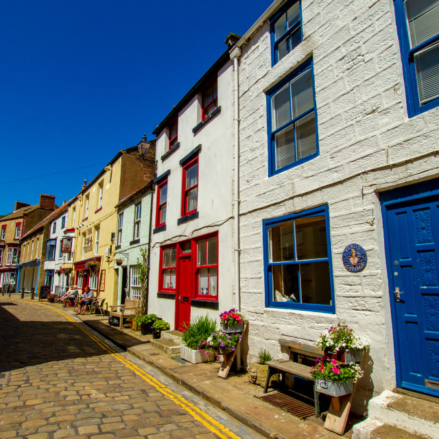"""Staithes, High Street Cottages and The Royal George Pub. Yorkshire, England."" stock image"