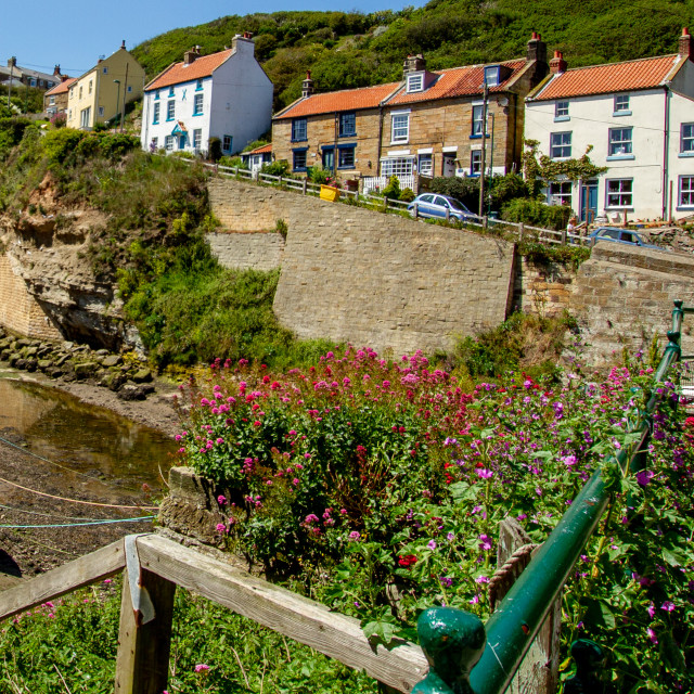 """Fishermens Cottages on Cowbar Bank, Moored Cobbles to the Foreground. Staithes, Yorkshire, UK"" stock image"