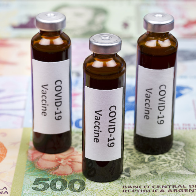 """Vaccine against Covid-19 on the background of Argentinian Pesos"" stock image"
