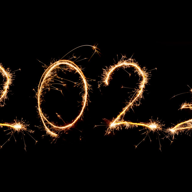 """2021 written with Sparkle firework on black background, happy ne"" stock image"