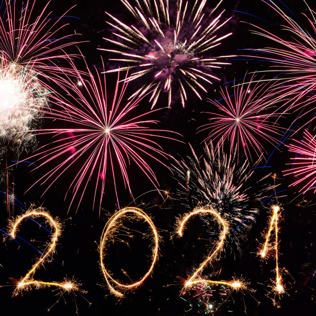 """2021 written with fireworks as a background"" stock image"