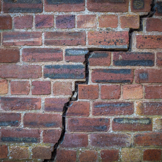 """Cracked Red Brick Wall"" stock image"