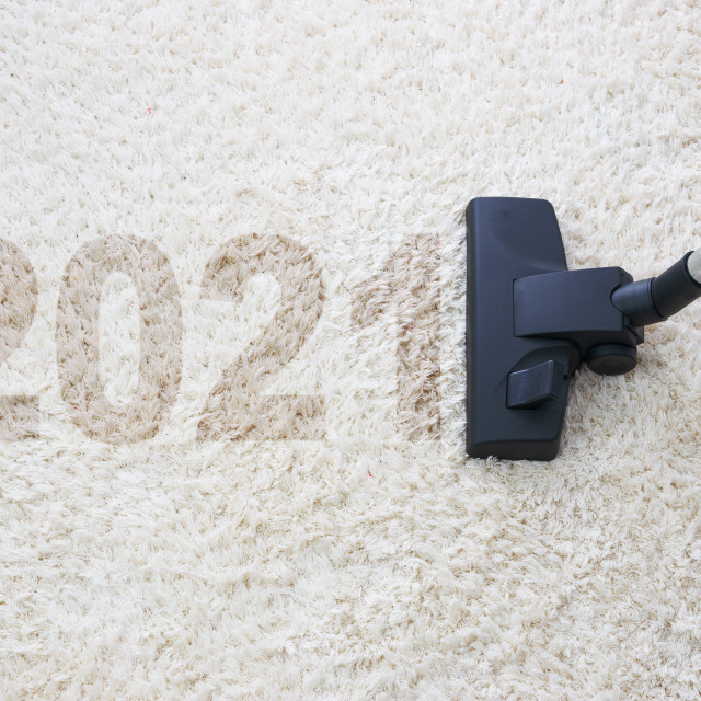 """2021 New year home cleaning with vacuum cleaner and copy space f"" stock image"