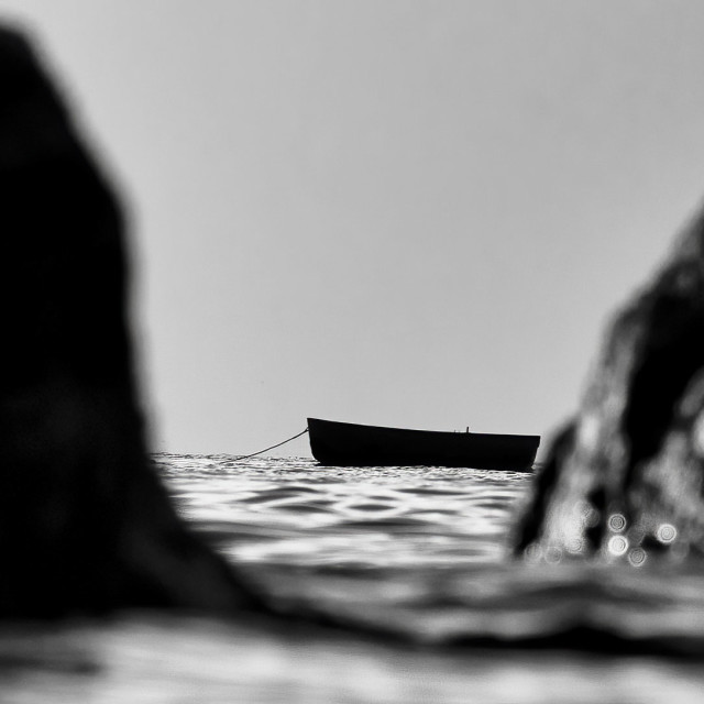 """""""A lone boat from Cawsand Bay, Cornwall UK."""" stock image"""