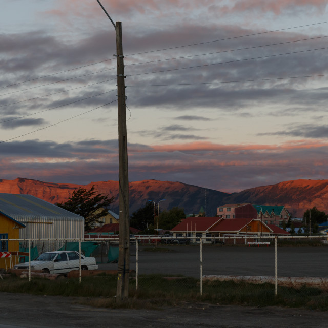 """Puerto Natales street and mountains view at sunset"" stock image"
