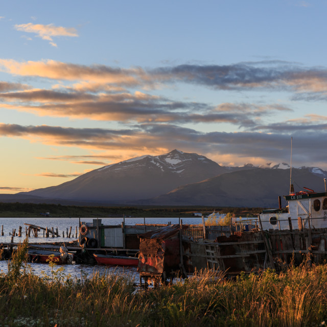 """Gaffos Pier, Admiral Montt Gulf, Puerto Natales in the evening sun"" stock image"