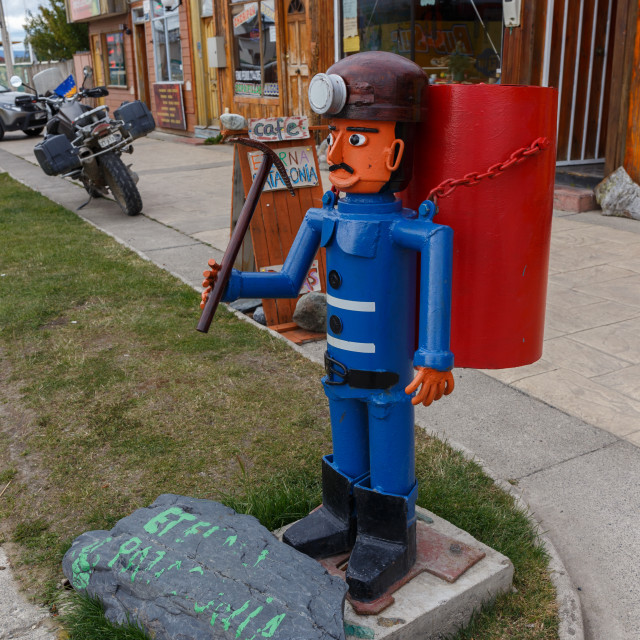 """Street litter bin in Puerto Natales in the form of a miner, Patagonia, Chile"" stock image"