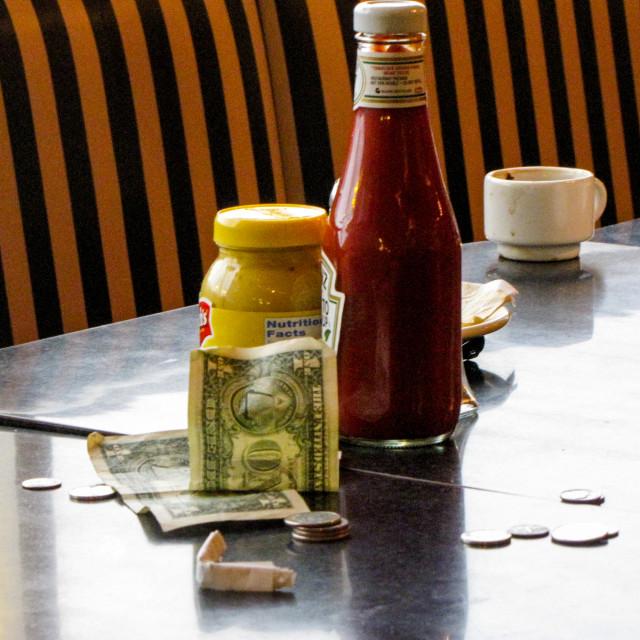 """Diners gone, tip left"" stock image"