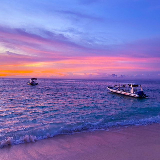 """Magenta Sunset on the Indonesian island of Nusa Lembongan"" stock image"