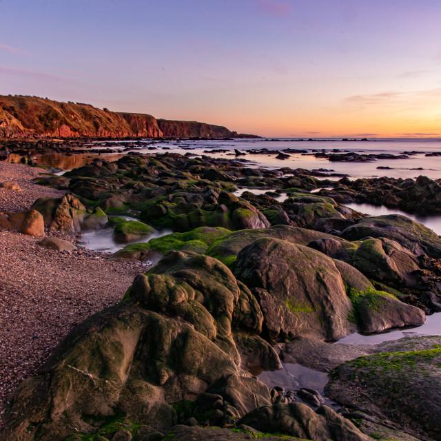 """Sunrise on Cowie Cliffs"" stock image"
