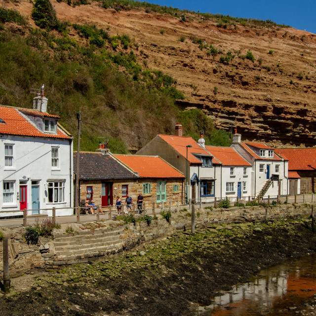 """Staithes, Northside, Wharfe, Quay and Fishermens Cottages. Yorkshire, England UK."" stock image"