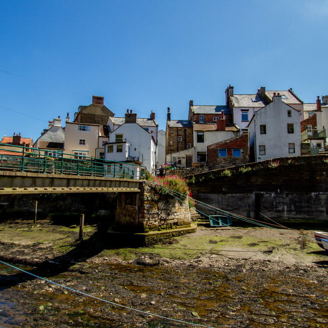 """Staithes Footbridge and Moored Fishing Boat in Staithes Beck, Yorkshire, England."" stock image"