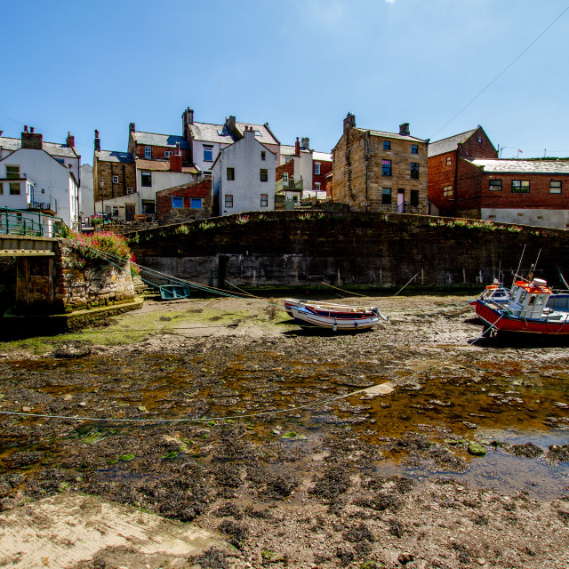 """Staithes Footbridge and Moored Fishing Boats in Staithes Beck, Yorkshire, England."" stock image"