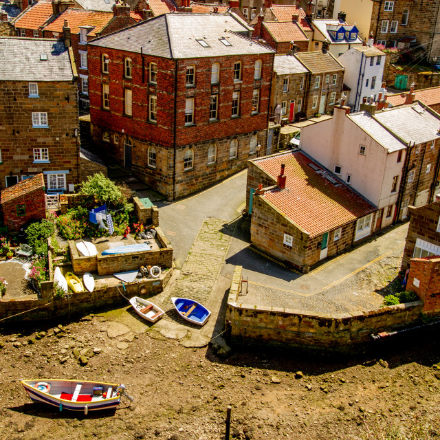 """Moored Fishing Boat in Staithes Beck, Slipway and Cottages to the Background. Staithes, Yorkshire, England."" stock image"