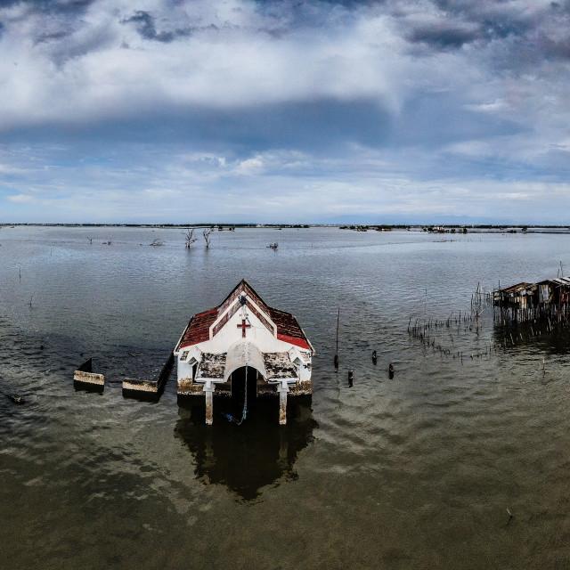 """Sinking Villages near Manila Bay"" stock image"