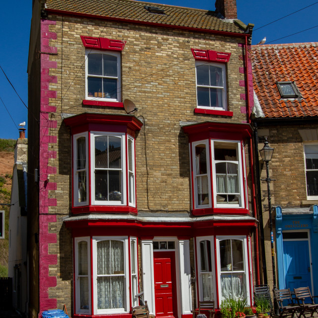 """Staithes, High Street, Three Story House."" stock image"