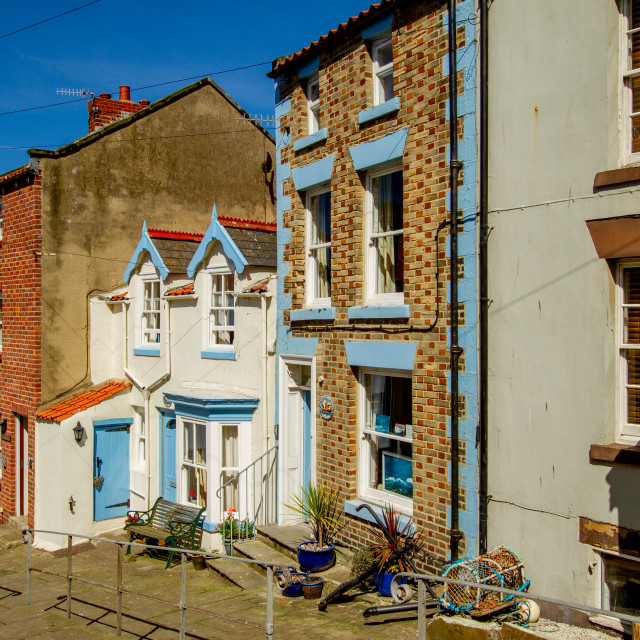 """Staithes, High Street Cottages and Houses in Sunshine. Yorkshire, England."" stock image"