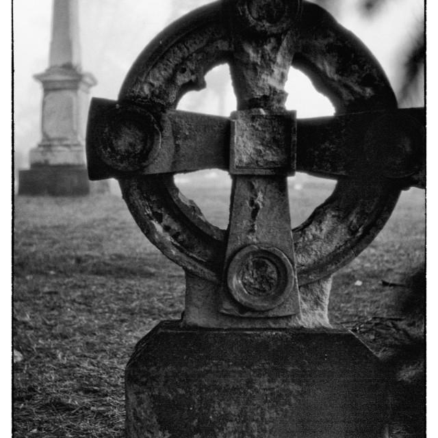 """Celtic cross gravestone in mist"" stock image"