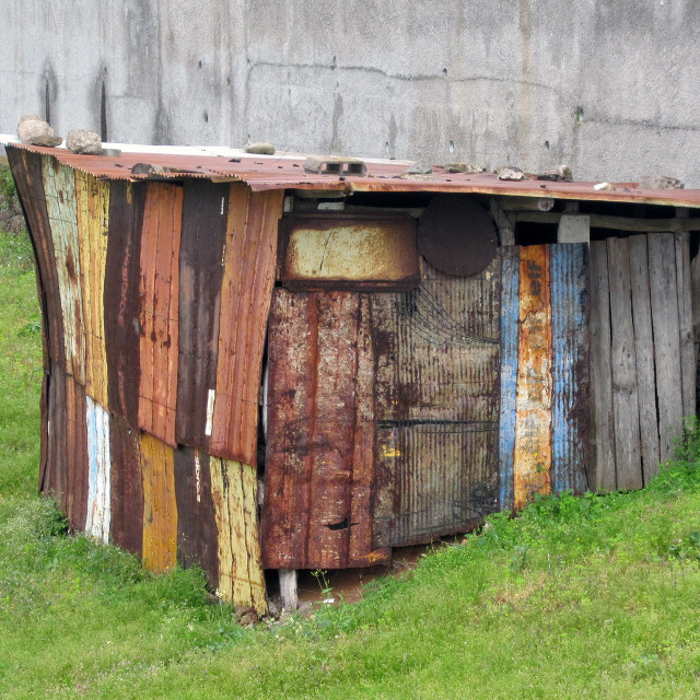 """""""Multi coloured corrugated tin shed in a field in Madeira"""" stock image"""