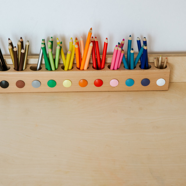 """""""colored pencils in a container on a wooden table"""" stock image"""