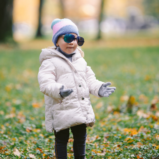 """""""young girl with adult glasses in the park autumn, funny"""" stock image"""