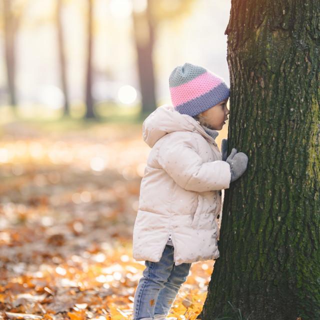 """""""little girl hugs a tree, autumn"""" stock image"""