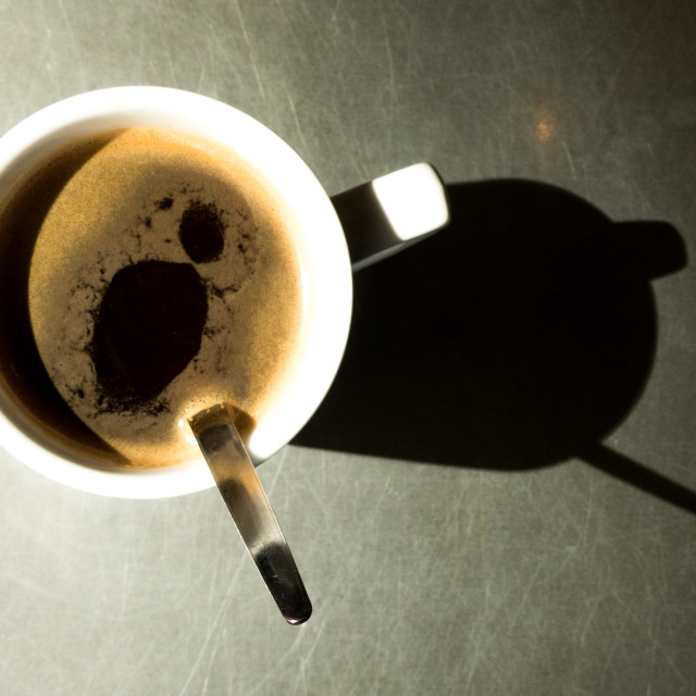 """Coffee cup and shadow"" stock image"