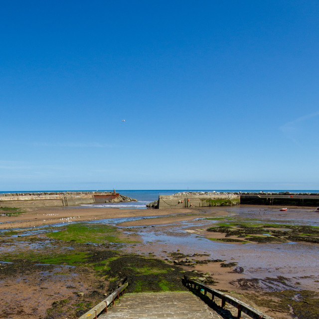 """Staithes Harbour at Low Tide, Slipway to the foreground, Yorkshire, England."" stock image"