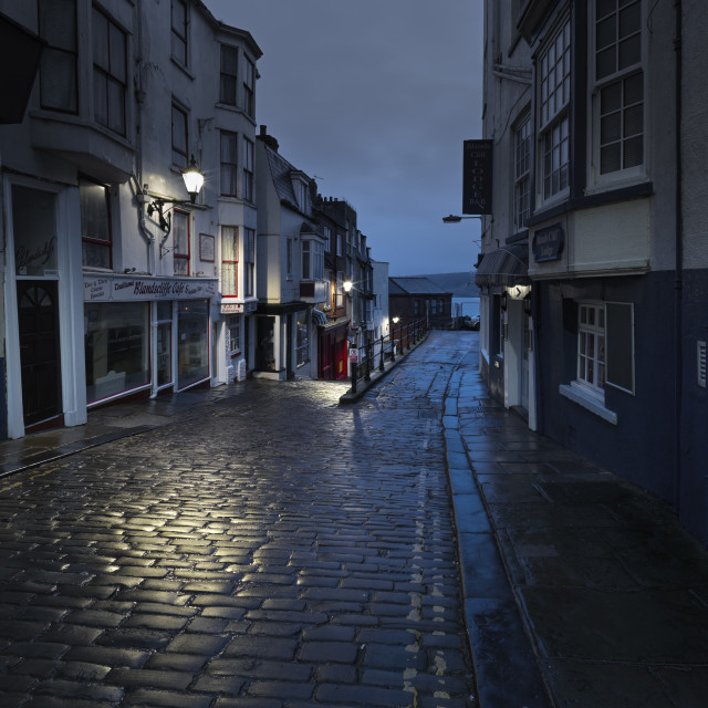 """""""It was a dark evening and the cobbles glowed"""" stock image"""