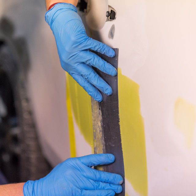 """""""Repairing car body, Application putty close up. The mechanic rep"""" stock image"""
