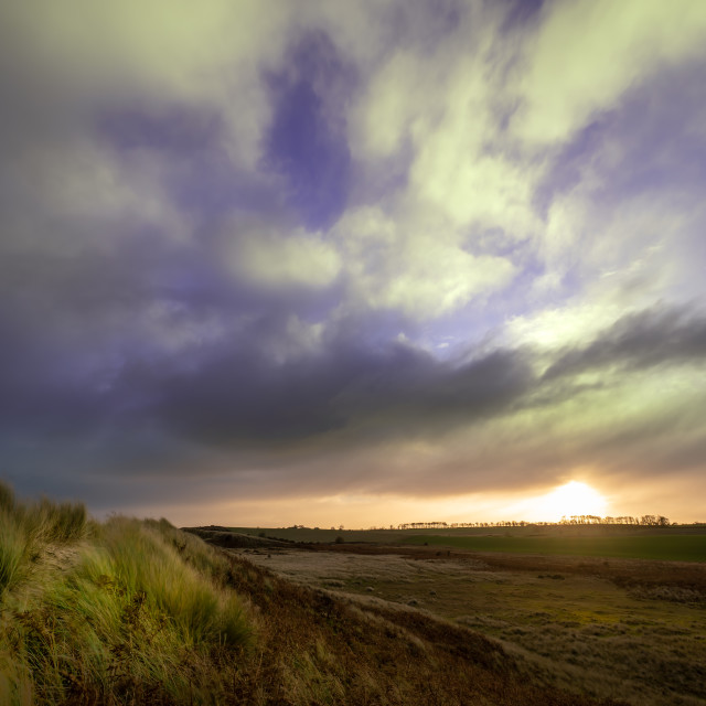 """""""Sunset over the Fields and Dunes"""" stock image"""