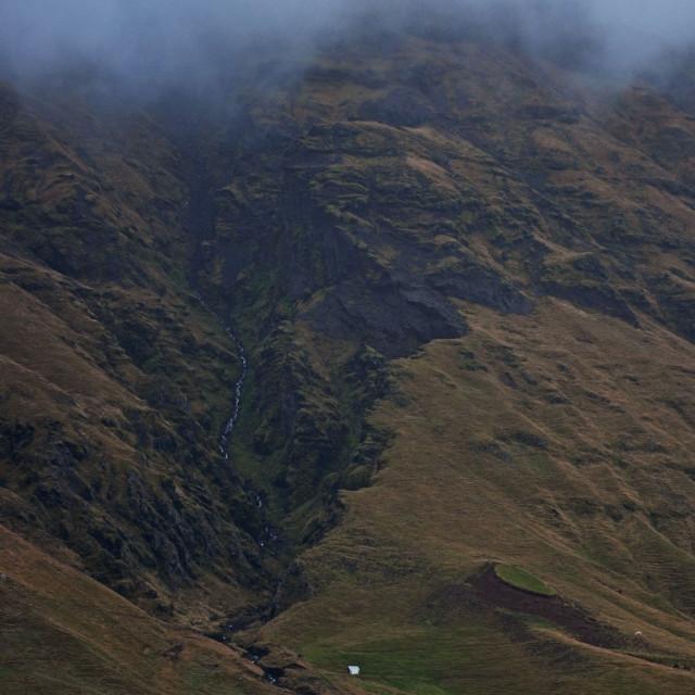 """Farm & cloud-topped mountain"" stock image"