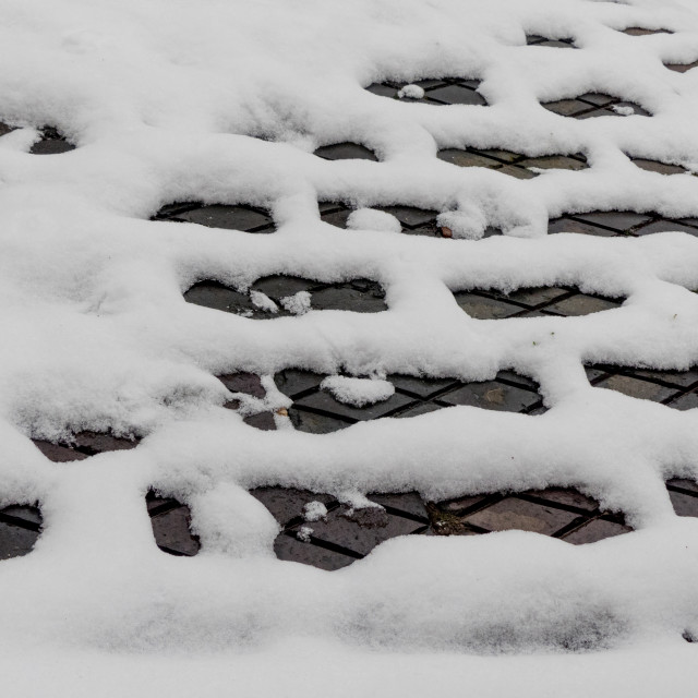 """Snow thawing on a Victorian brick yard"" stock image"