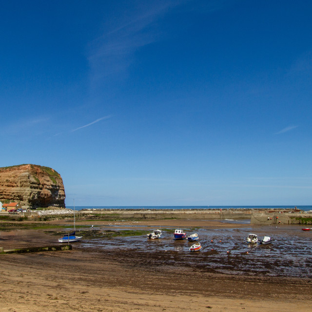 """Staithes Harbour at Low Tide, Cowbar Nab in the Background, Yorkshire, England."" stock image"