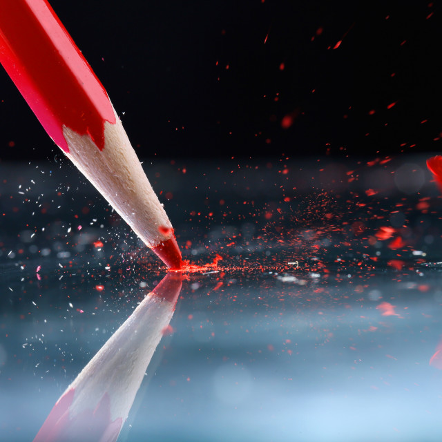 """A red crayon damaged by pressure on the glass."" stock image"