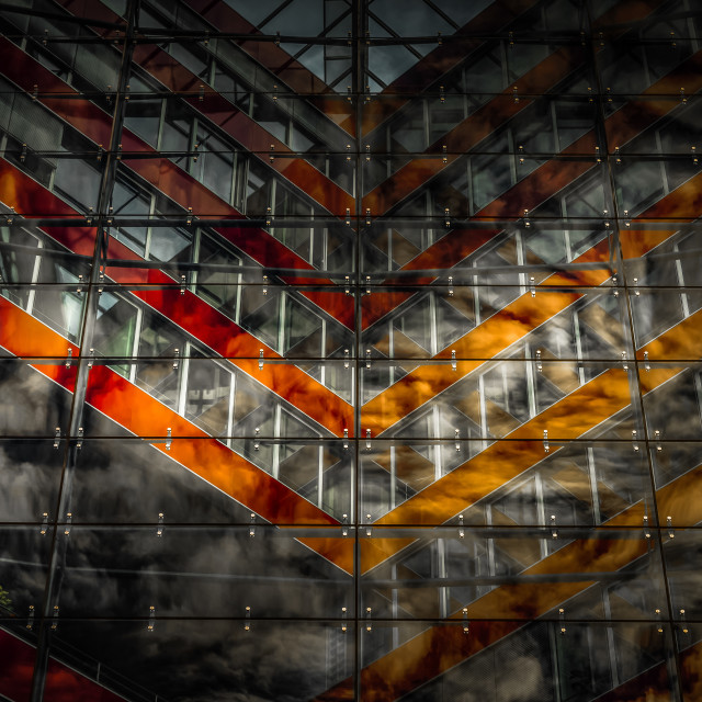 """""""""""Lonesome Tree"""" - Reflections of clouds on glass facade of office building"""" stock image"""