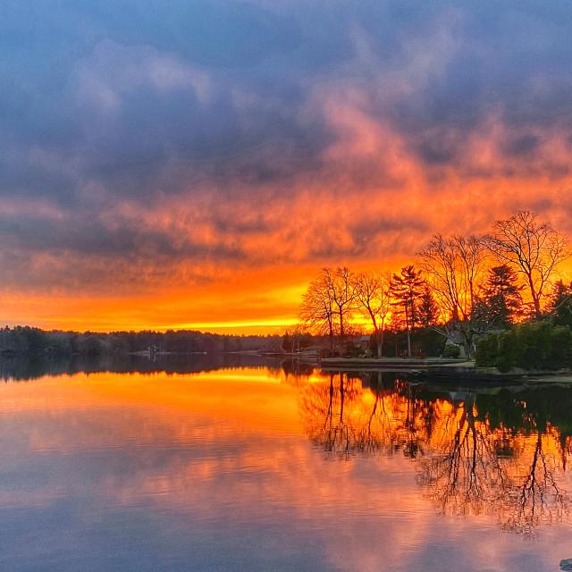 """Sunrise over Tiogue Lake"" stock image"