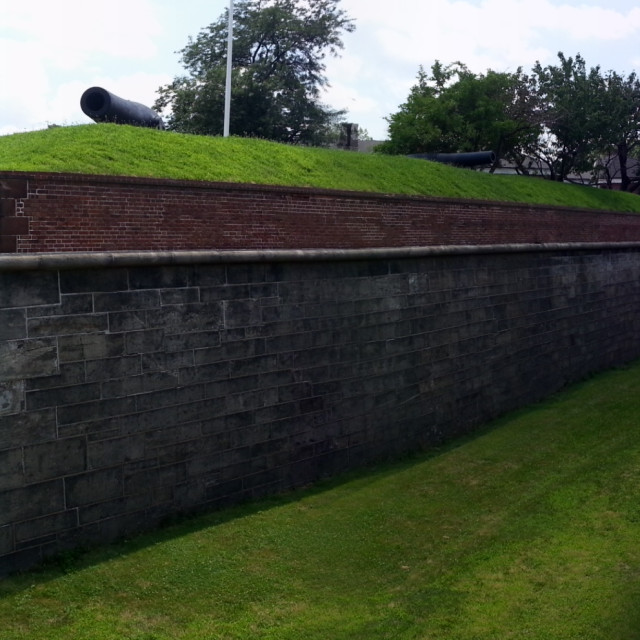 """""""Fort Jay moat & walls"""" stock image"""